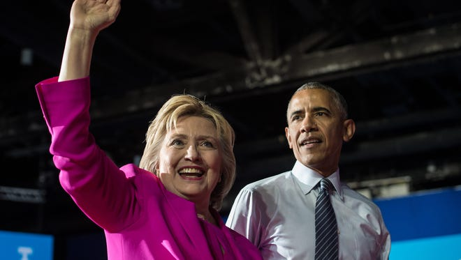 President Obama and Democratic presidential nominee Hillary Clinton leave a campaign event  in Charlotte, North Carolina, on July 5, 2016.