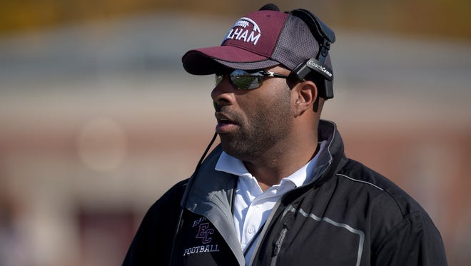 Earlham College football coach Nick Johnson leads the Quakers Saturday, Nov. 5, during a football game against Bluffton at Earlham College in Richmond.