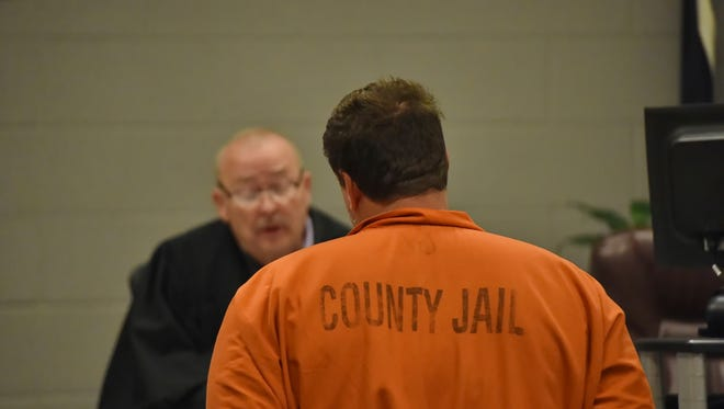Todd Kohlhepp is addressed by Judge Jimmy Henson during a bond hearing at the Spartanburg Detention Facility, in Spartanburg, S.C. Sunday, Nov. 6, 2016.  The judge denied bond for Kohlhepp, charged with a 2003 quadruple slaying and more recently holding a woman captive on his property.