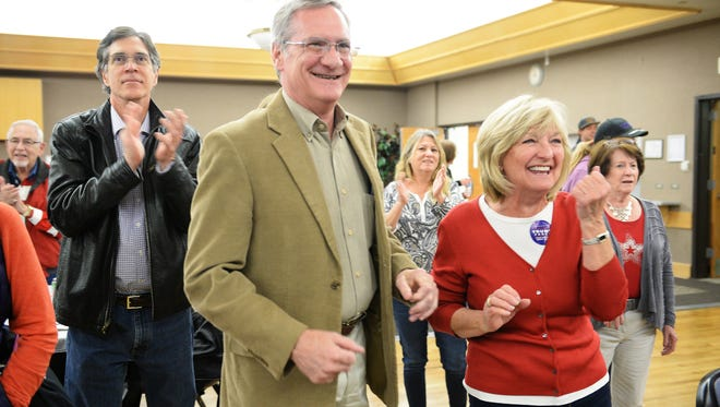 Neil McCaffrey and Stephanie Eyster react as Fox News calls Florida for Donald Trump at the Larimer County GOP watch party at the Fort Collins Senior Center on Tuesday.