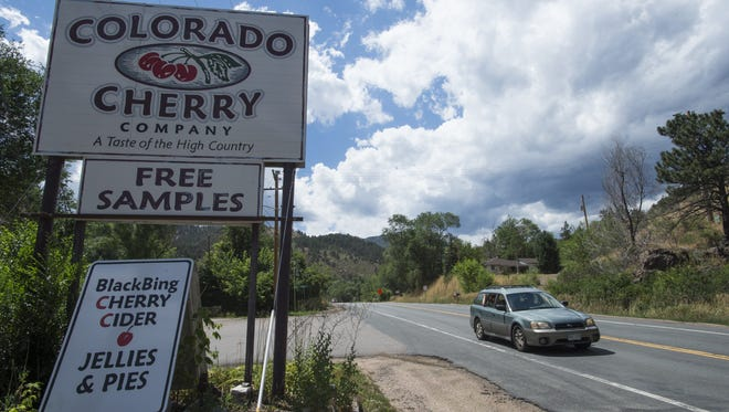 Traffic flows on U.S. Highway 34 outside the Colorado Cherry Company in Big Thompson Canyon in August. The highway will be closed for eight months to repair it from damaged caused by the 2013 flood.