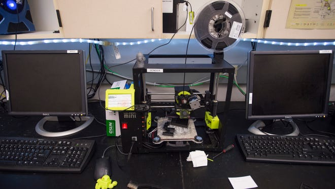 A 3-D printer works on a project at the Idea2Product Lab in the engineering building in 2016. The lab provides services and training on the printers and is seeking funds to expand.