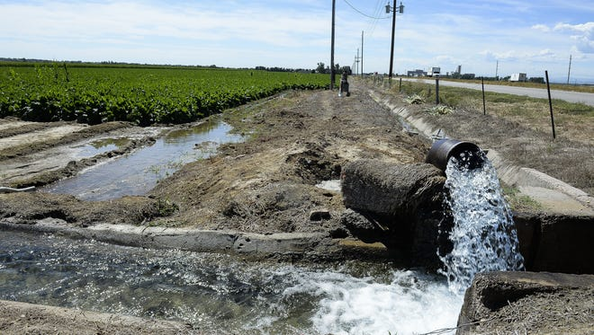 Water flows into a farm field owned by the city of Thornton off County Road 56 in 2015. The city has identified a corridor for a pipeline that would carry Poudre River water to Thornton.