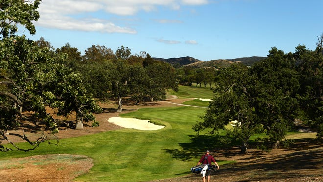 Al Dellinger walks onto the sixth fairway where new sand traps, less sod and more draught-minded landscaping covers the area at Los Robles Greens Golf Course in Thousand Oaks.