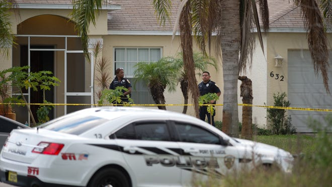 The scene of a fatal police-involved shooting on the 600 block of Southwest Colleen Avenue in Port St. Lucie is seen Friday, Nov. 18, 2016, where Samson Fleurant was fatally shot by a Port St. Lucie police officer responding to a domestic disturbance call, according to authorities.