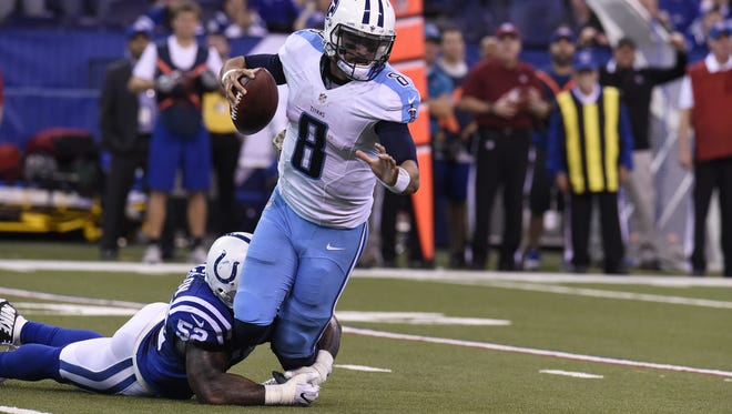 Colts' D'Qwell Jackson sacks Titans QB Marcus Mariota with 8 minutes to go in the fourth quarter Sunday, Nov. 20, 2016.