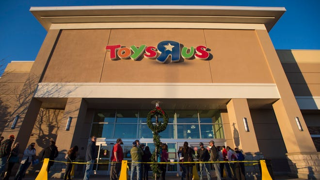 People wait for doors to open to take advantage of Black Friday deals at Toys R Us at Front Range Village in south Fort Collins Thursday, November 24, 2016. The store is expected to close as part of its corporate bankruptcy.