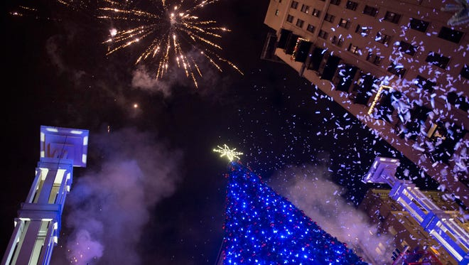 Confetti and fireworks fill the sky during the City of Knoxville's lighting of the downtown Christmas tree to kick off the 2016 Christmas in the City celebration.