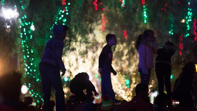 Children dance at the annual Glendale Glitters street fair in downtown Glendale on Saturday, Nov. 26, 2016.