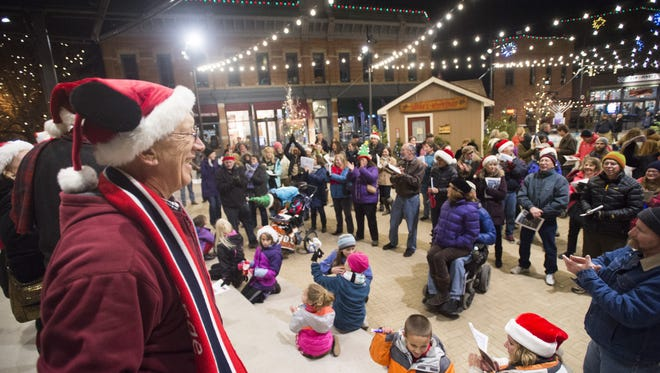 Neil Johnson of the Choice City Singers leads Old Town Square in singing Christmas Carols in 2015.