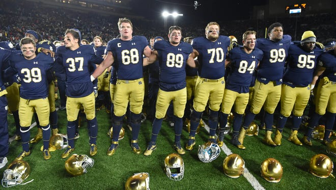 Nov 19, 2016; South Bend, IN, USA; The Notre Dame Fighting Irish sing their alma mater after a game against the Virginia Tech Hokies at Notre Dame Stadium. Virginia Tech won 34-31. Mandatory Credit: Matt Cashore-USA TODAY Sports