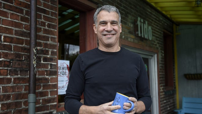 Bob Bernstein stands outside his restaurant Fido on Wed. Nov. 30, 2016, in Nashville, Tenn. Bernstein was a pioneer in Nashville's dining scene in the '90s, helping to shape the way for restaurateurs to come. He has new concepts as Fido turns 20 this year.
