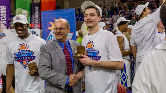 "ASUN commissioner Ted Gumbart (pictured with now-graduated FGCU guard Christian Terrell) said adding Liberty is ""a win all the way around."""