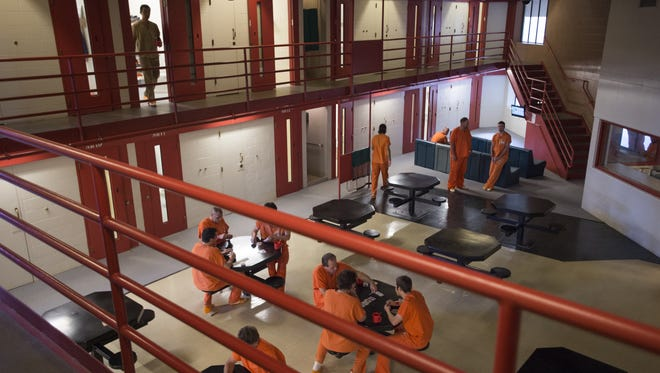 Inmates move around a housing area at the Larimer County Jail on Sept. 30, 2016.