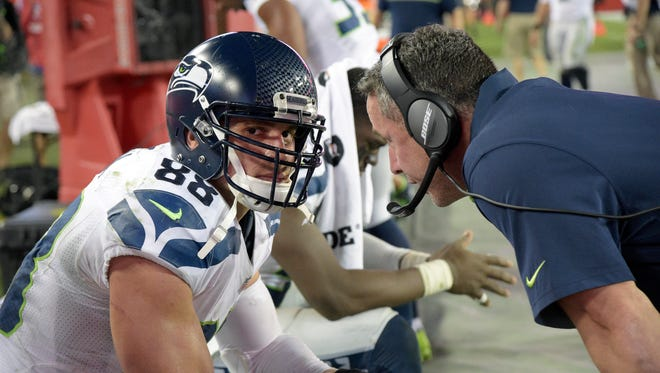Seattle Seahawks tight ends coach Pat McPherson, right, talks with tight end Jimmy Graham (88) on the bench at the end of the second half of an NFL football game against the Tampa Bay Buccaneers in Tampa, Fla., Sunday, Nov. 27, 2016.
