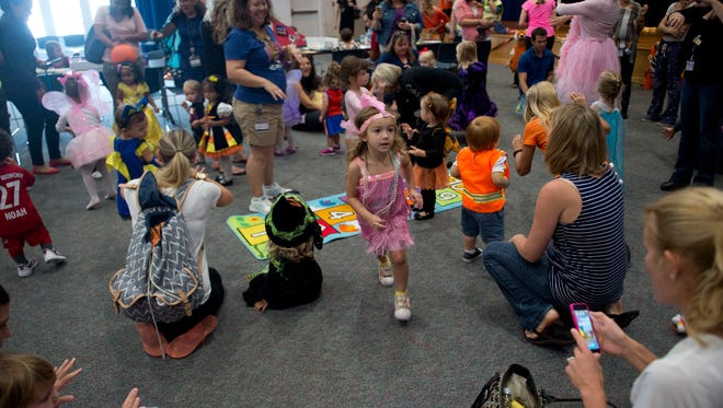 Nearly 200 babies, toddlers and their families attended the Martin County Library System's sixth annual Halloween Party and Parade at Blake Library in Stuart on Friday, Oct. 28, 2016.
