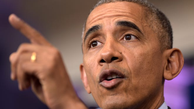President Barack Obama speaks during a news conference Friday in the briefing room of the White House.