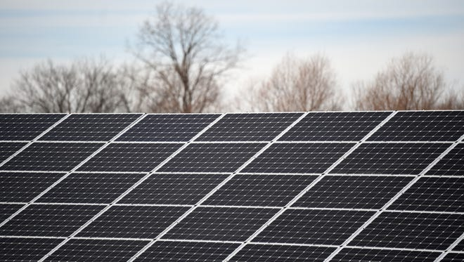 Solar panels Tuesday, Dec. 20, 2016, provide energy to Cope Environmental Center's new green building in Centerville as well as adding power to the grid.
