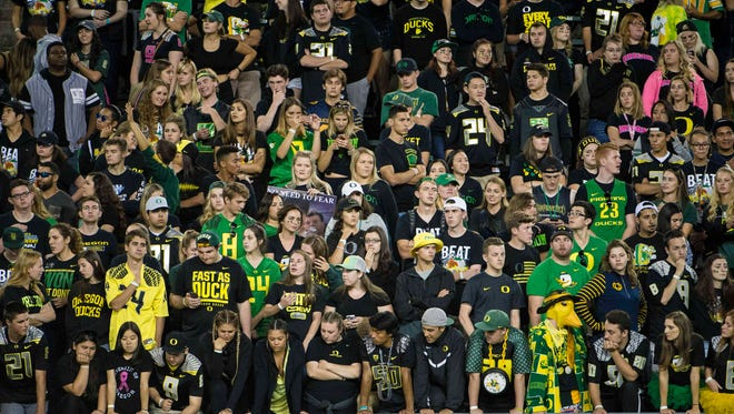 Oct 8, 2016; Eugene, OR, USA; University of Oregon Ducks fans watch from the stands during the third quarter in a game against the University of Washington at Autzen Stadium. The Huskies won 70-21. Mandatory Credit: Troy Wayrynen-USA TODAY Sports