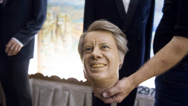 The wax head of President Jimmy Carter is held in a worker's hand after an auction at the Hall of Presidents and First Ladies Museum in Gettysburg on Saturday, Jan. 14.