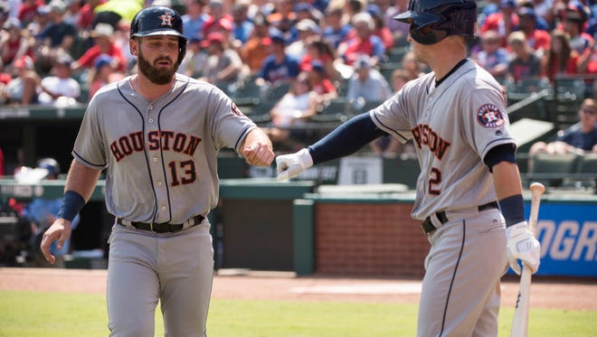 Sep 4, 2016; Arlington, TX, USA; Houston Astros first baseman Tyler White (13) and second baseman Alex Bregman (2) celebrate White scoring against the Texas Rangers during the fourth inning at Globe Life Park in Arlington. Mandatory Credit: Jerome Miron-USA TODAY Sports