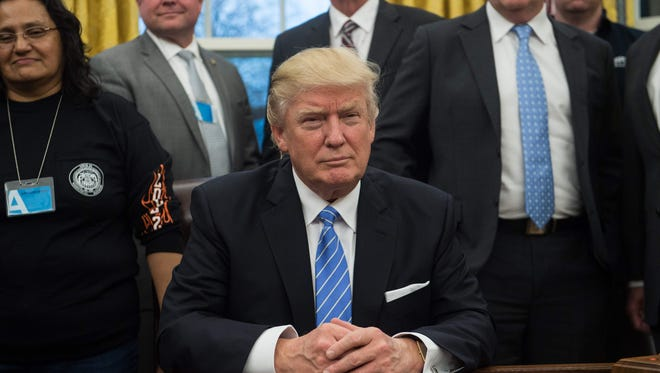 President Trump is shown in the Oval Office on Jan. 23, 2017.