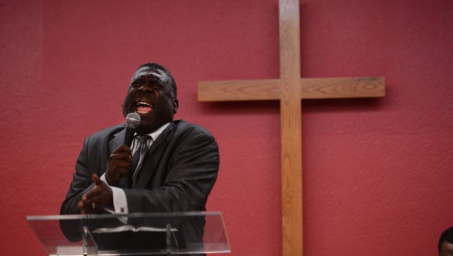 Bishop Broderick A. Huggins conducts a service last year at St. Paul Baptist Church in Oxnard. The pastor is embroiled in a power struggle with a group of deacons.