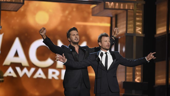 Co-hosts Luke Bryan, left, and Dierks Bentley open the show for the 51st Academy of Country Music Awards at the MGM Grand Garden Arena on April 3, 2016, in Las Vegas. They'll return to ACM hosting duties on Sunday.