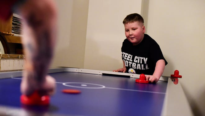 Ayden Zeigler-Kohler plays at his home in Springettsbury Township. The 10-year-old has DIPG, a rare childhood cancer. Support has poured in for the boy and his family after they shared their story.