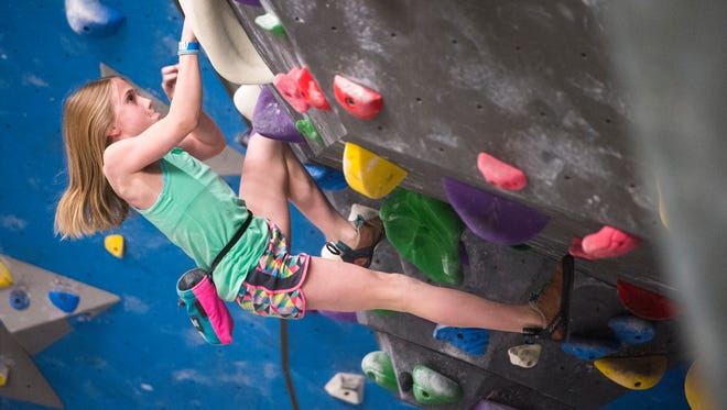Harper Allen, 11, of Knoxville concentrates while participating in a bouldering competition Saturday, Feb. 25, 2017, at Onsight Rock Gym in Knoxville.