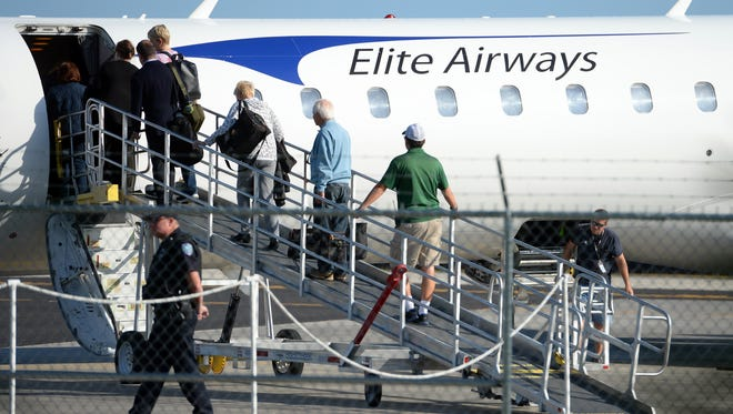 Passengers begin the boarding process on an Elite Airways plane headed to Newark, New Jersey, on March 9, 2017, at the Vero Beach Regional Airport. Seven flights will leave Vero Beach Regional Airport for New Bedford, Massachusetts, on Dec. 23 and 30 and Jan. 1.