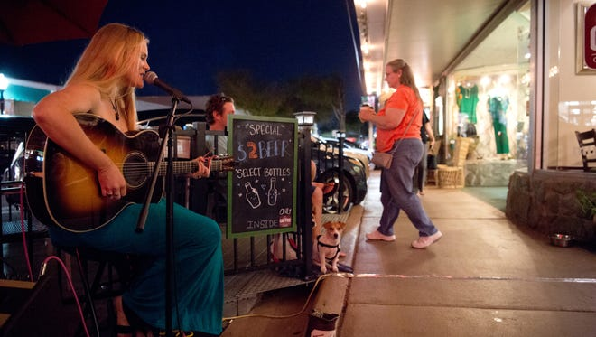 Abby Owens performs on Southwest Osceola Street during the Spring Stuart Stroll, presented by the Downtown Business Association and Stuart Main Street, on March 9, 2017, in downtown Stuart. SmartAsset ranked Stuart as the fifth best place to retire in Florida.