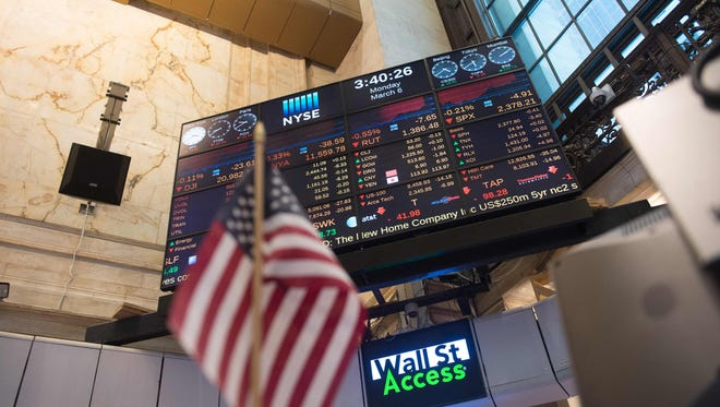A video board is seen near the closing bell of the Dow Jones at the New York Stock Exchange.