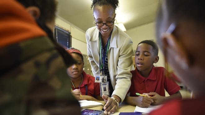 In this file photo, Dr. Paula Pendergrass works with Truly Eckles, 9, and Darvin Dalmacy, 9, in her Encore gifted services class at Una Elementary Thursday Feb. 4, in Nashville, Tenn.