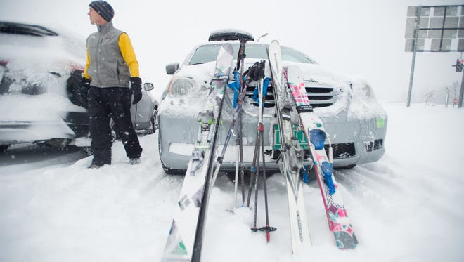 John Madden of Shelburne waits for his ski buddy Wednesday morning, March 15, 2017. With Stella still dumping snow throughout Vermont, Madden was heading to Sugarbush Resort with his two daughters.