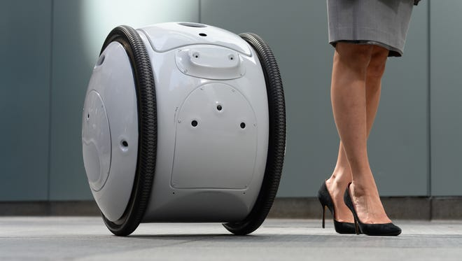 3/13/17 8:26:08 AM -- New York, NY, U.S.A  -- On Monday, a Cambridge, MA., company named Piaggio Fast Forward, will be bringing their robot Gita to the NYC bureau. Apparently this robot follows people around and helps them carry things.   --    Photo by Robert Deutsch, USA TODAY staff ORG XMIT:  RD 136103 Gita robot 03/13/2017 [Via MerlinFTP Drop]