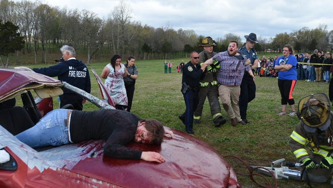 Students and emergency personnel participate in a staged re-enactment of a prom-night crash Wednesday at Arkansas State University-Mountain Home. The mock event, called The Last Dance, is put on for area students to show them the consequences of drunk and distracted driving.