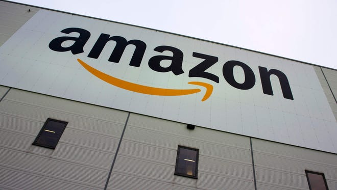 The Amazon logo appears on the company's logistics center in Brieselang, Germany, west of Berlin.