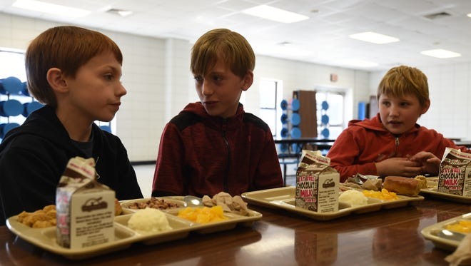 Danny Mize (from left), James May and Seth Juber chat during lunch on Thursday at Amanda Gist Elementary School. The school was among several schools in the state that received the Beating the Odds title by the Office for Education Policy.