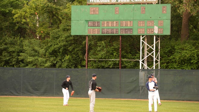 Richmond Jazz players practice Thursday, June 2, 2016 in front of a scoreboard that bears John Cate's name.