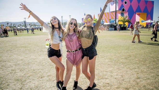 Festival goers pose at Coachella on April 15, 2017.