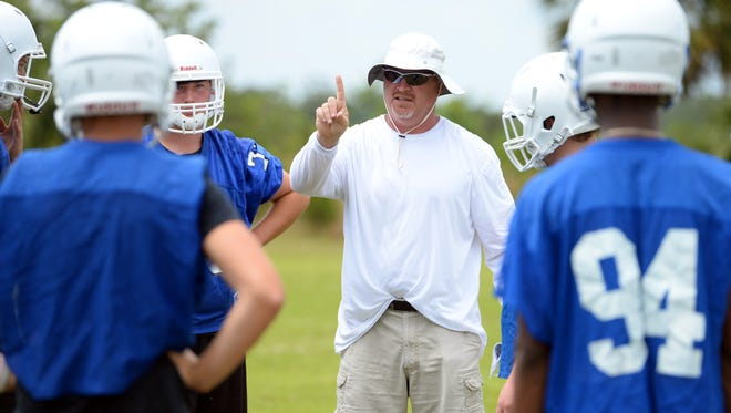 Sebastian River High School head football coach Chuck Kenyon speaks during spring practice Monday, April 24, 2017. Kenyon announced Monday, June 25, 2018, he was stepping down at Sebastian River to take an assistant coaching job in Georgia.
