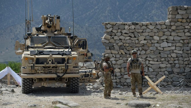 U.S. soldiers patrol near the site of a U.S. bombing during an operation against Islamic State militants in the Achin district of Afghanistan's Nangarhar province on April 15, 2017.