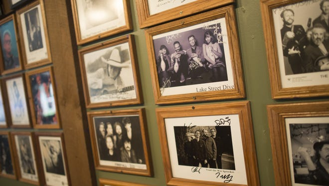 Autographed photos of past performers line the walls at the Mishawaka on Wednesday, May 10, 2017. The concert venue and Poudre Canyon pit stop is gearing up for the busy season.