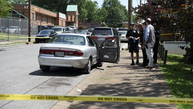 Nashville Metro Police respond to the scene of a shooting in Cayce Homes on Friday, May 19, 2017 in Nashville, Tenn.