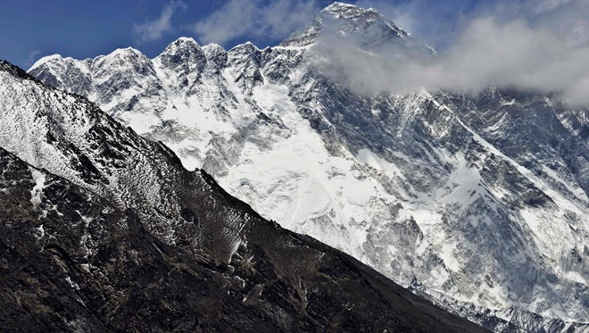 Mount Everest is seen in the background from the village of Tembuche in the Kumbh region of north-eastern Nepal.