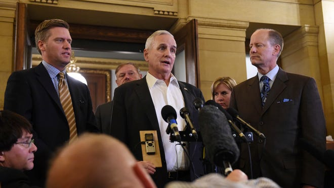 Minnesota Speaker of the House Kurt Daudt, from left, Gov. Mark Dayton and Senate Majority Leader Paul Gazelka talk to the media on the final day of the regular session at the State Capitol in St. Paul,  Monday, May 22.