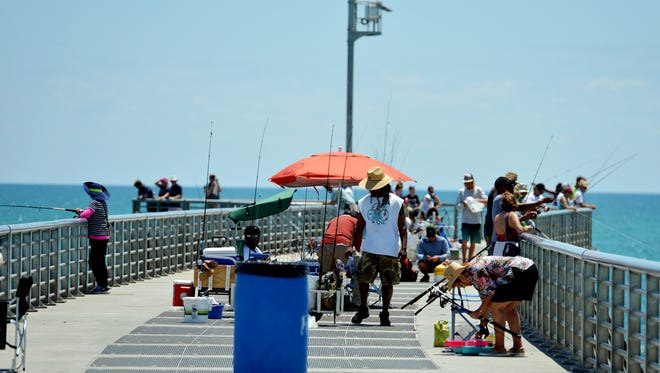 People fish at the Sebastian Inlet State Park on May 12, 2016.