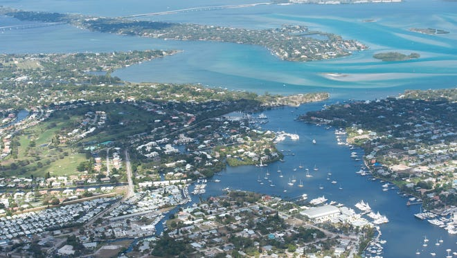 This aerial image shows Manatee Pocket in Port Salerno, the St. Lucie River, the Indian River Lagoon, Hutchinson Island and the Atlantic Ocean in February. Property values across Martin County increased about 5.3 percent from last year, according to preliminary estimates.