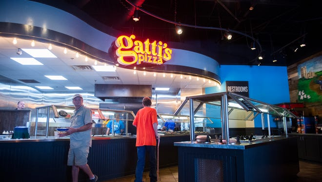 Patrons get pizza at the recently renovated Gatti's Pizza in Halls on Maynardville Pike on Saturday June 10, 2017. $250,000 was recently spent to renovate the Gatti's Pizza locations in Halls and Maryville.